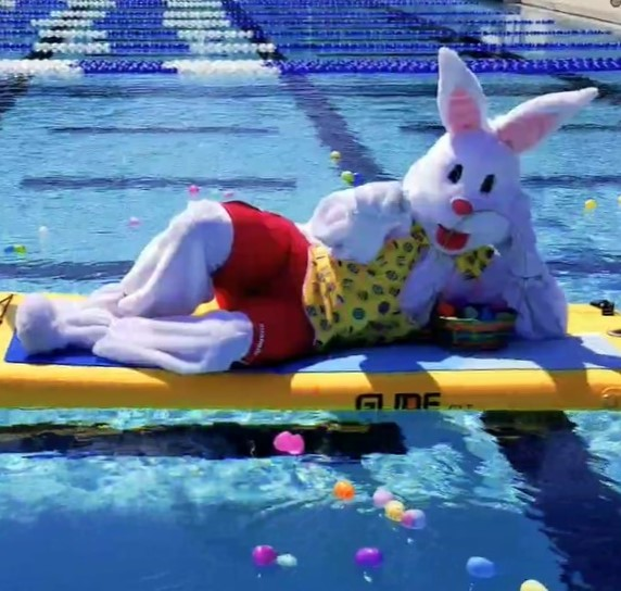 Bunny costume resting on a floating yoga board in the pool